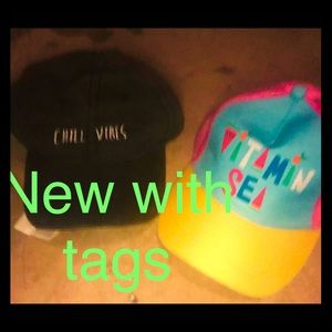 Two brand new hats is. With tags still on